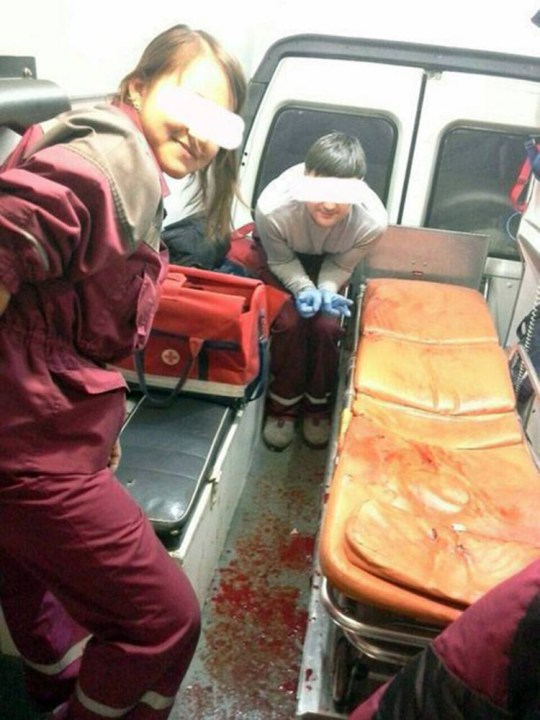 "Pic shows: selfie in front of the patient's blood that is on the floor. Health officials are investigating after paramedics took selfie's of themselves with a patient covered in blood on board an emergency ambulance and then posted them online. The images show a male and female paramedic and were taken in the city of Perm in central Russia's Perm Oblast where health officials are investigating. The first picture shows the two paramedics posing with a body of their patient covered in blood. The tattooed man had reportedly in a knife attack and was being taken to hospital for emergency treatment. The second picture features a smiling paramedic making the sign of victoria with the empty patient bed surrounded by bloodstains. The girl who uploaded the pictures on her page in the Russian social media page Vkontake and Instagram also included details about the accident and defended the decision to take the snaps against critics. She also offered to take other images involving different injuries to patients. However, Pavel Stefan from the local health watchdog said it breached all the ethical guides and added: ""We have created a commission to deal with this incident."" He added that there will be attended to find out who took the pictures and when, and warned that on the face of it appeared to go against all the normal standards accepted for medical personnel, and if this is confirmed there will be sanctions against those who are involved."" (ends)"