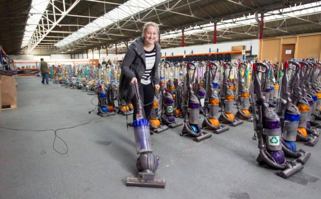 PIX PAUL LEWIS...moneymails Victoria Bischoff at John Pye Auctions West Midlands hub, Marchington, nr Uttoxeter...they auction goods from major retailers....Alison with selection of Dyson cleaners in the sale.