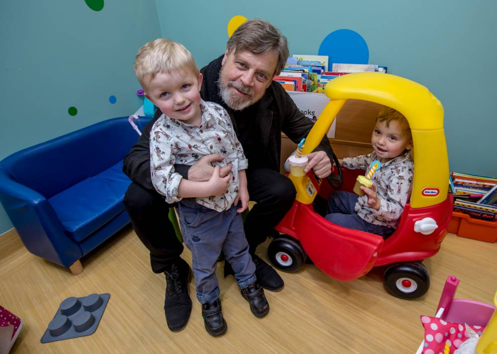 Actor Mark Hamill aka Luke Skywalker visits kids at Gt Ormond St Hospital. Pic shows:- Mark with twins Oscar (L) and Finlay (in car), three.