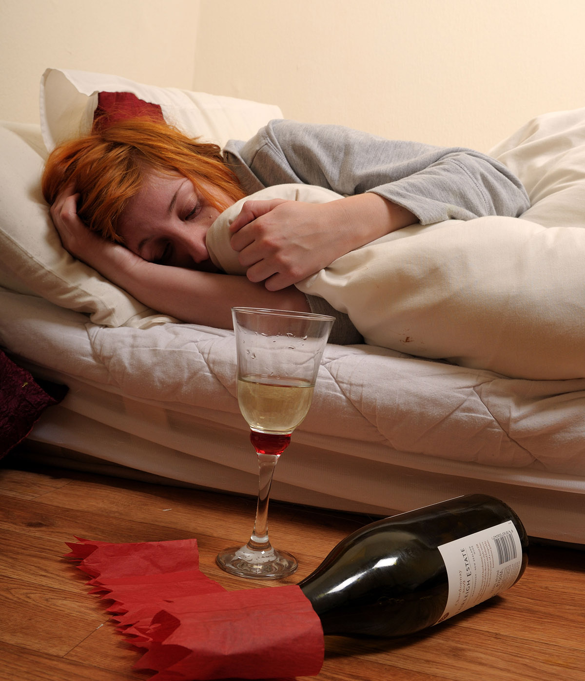 CC483E Young Women in Bed with Hangover after Party . Alamy