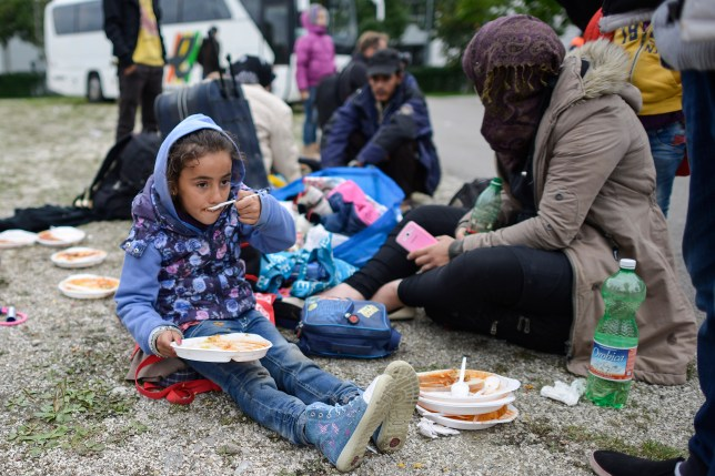 Syrian asylum seeker Dima, 5, eating dinner at a refugee accommodation facility (Picture: Getty Images)
