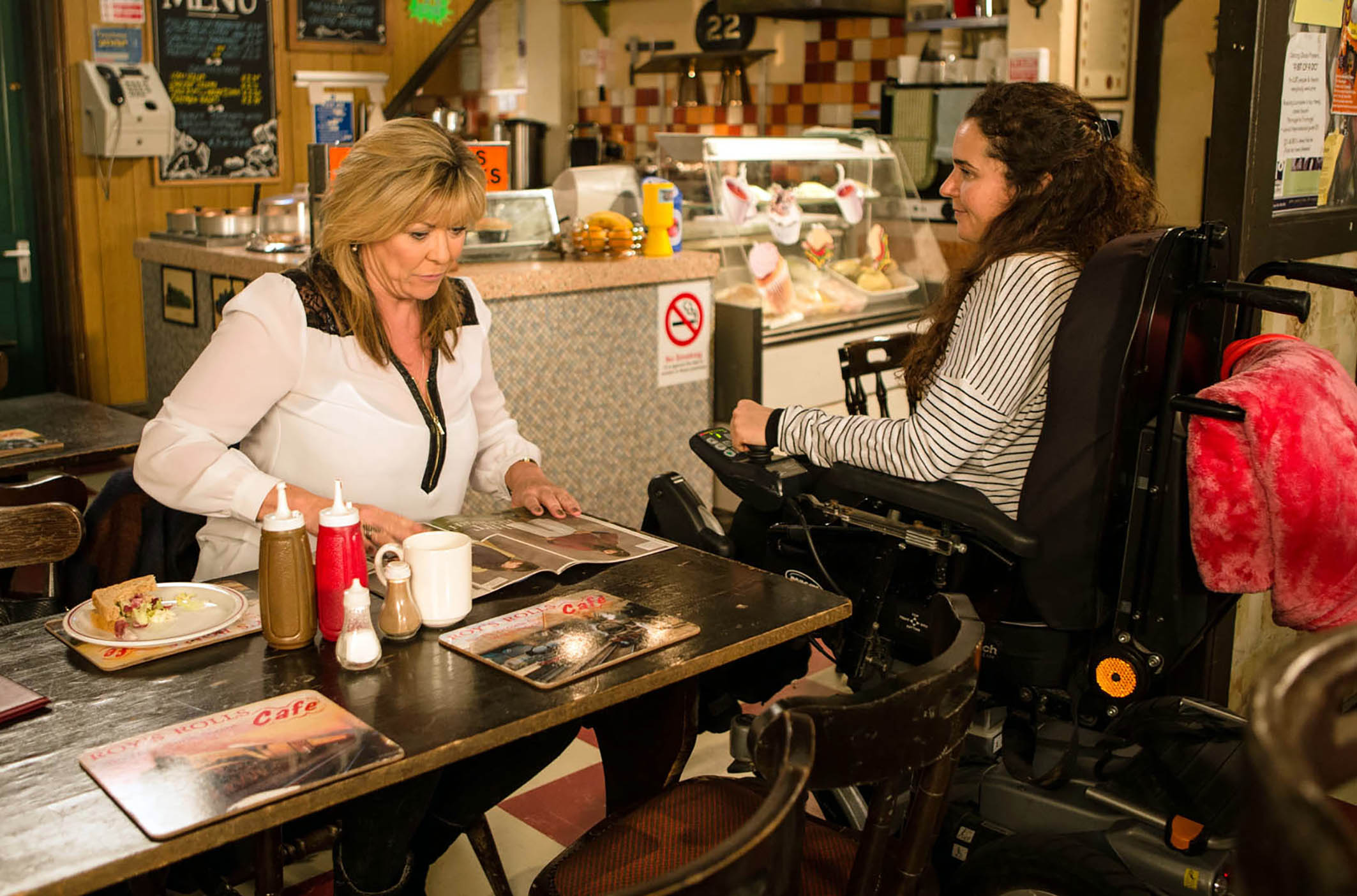 FROM ITV STRICT EMBARGO - No Use Before Tuesday 2 February 2016 Coronation Street - Ep 8837 Friday 12 February 2015 - 1st Ep Izzy Armstrong [CHERYLEE HOUSTON] confides In Erica Holroyd [CLAIRE KING] that since dislocating her hip, she's been in terrible pain and her painkillers aren't working. Erica offers to get her some cannabis but Izzy's not keen. Picture contact: david.crook@itv.com on 0161 952 6214 Photographer - Mark Bruce This photograph is (C) ITV Plc and can only be reproduced for editorial purposes directly in connection with the programme or event mentioned above, or ITV plc. Once made available by ITV plc Picture Desk, this photograph can be reproduced once only up until the transmission [TX] date and no reproduction fee will be charged. Any subsequent usage may incur a fee. This photograph must not be manipulated [excluding basic cropping] in a manner which alters the visual appearance of the person photographed deemed detrimental or inappropriate by ITV plc Picture Desk. This photograph must not be syndicated to any other company, publication or website, or permanently archived, without the express written permission of ITV Plc Picture Desk. Full Terms and conditions are available on the website www.itvpictures.com