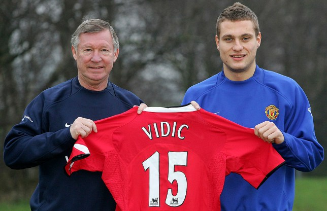 MANCHESTER, ENGLAND - JANUARY 9: Sir Alex Ferguson of Manchester United poses with new signing Nemanja Vidic at the press conference to announce his signing at Carrington Training Ground on January 9, 2006 in Manchester, England. (Photo by Matthew Peters/Manchester United via Getty Images)