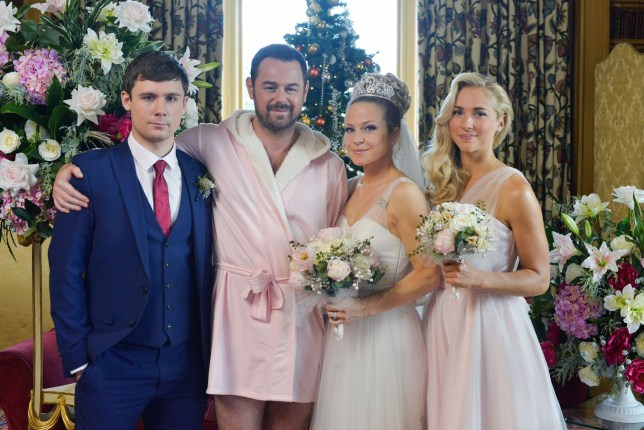 WARNING: Embargoed for publication until 00:00:01 on 08/12/2015 - Programme Name: EastEnders - TX: 01/01/2016 - Episode: 5203 (No. n/a) - Picture Shows: Mick and Linda get married! Lee Carter (DANNY-BOY HATCHARD), Mick Carter (DANNY DYER), Linda Carter (KELLIE BRIGHT), Nancy Carter (MADDY HILL) - (C) BBC - Photographer: Kieron McCarron