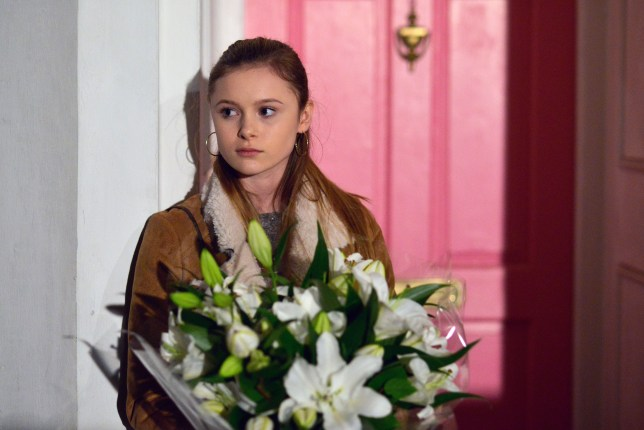 WARNING: Embargoed for publication until 00:00:01 on 26/01/2016 - Programme Name: Eastenders - TX: 01/02/2016 - Episode: 5221 (No. n/a) - Picture Shows: Hannah knocks on Ronnie's door. Hannah (MIA JENKINS) - (C) BBC - Photographer: Kieron McCarron