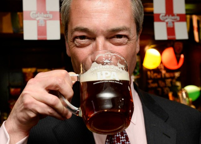 The leader of Britain's United Kingdom Independence Party (UKIP), Nigel Farage, drinks a pint at the Hoy and Helmet pub in South Benfleet, southern England May 23, 2014. Britain's anti-EU party UKIP made strong gains in local elections in England, siphoning support from Prime Minister David Cameron's Conservatives as it capitalized on discontent about immigration and mainstream politics. REUTERS/Suzanne Plunkett (BRITAIN - Tags: POLITICS ELECTIONS TPX IMAGES OF THE DAY) - RTR3QJ4R