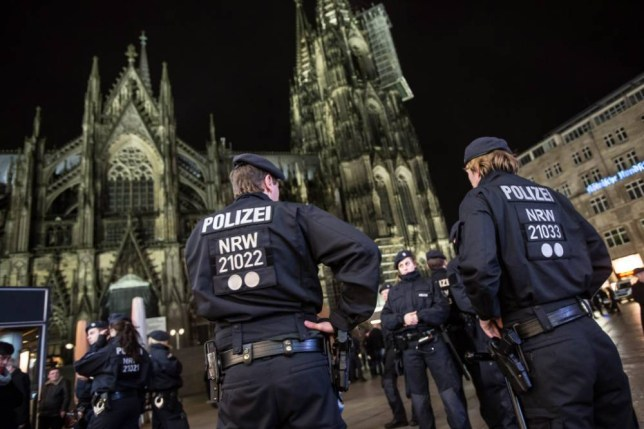 epa05096067 Police forces guard the area around the Cathedral in Cologne, Germany 10 January 2016. Police presence was beefed up in consequence to the New Year's Eve's attacks. The number of cases reported to Cologne police following a night of mass sex assaults and thefts continued to rise sharply, with the latest official figures rising to 516 complaints from a previous 379, around 40 per cent of the complaints involve allegations of sexual assault, according to the police statement. EPA/MAJA HITIJ
