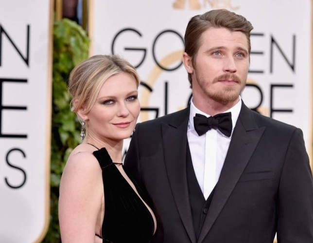 BEVERLY HILLS, CA - JANUARY 10: Actors Kirsten Dunst (L) and Garrett Hedlund attend the 73rd Annual Golden Globe Awards held at the Beverly Hilton Hotel on January 10, 2016 in Beverly Hills, California. (Photo by John Shearer/Getty Images)