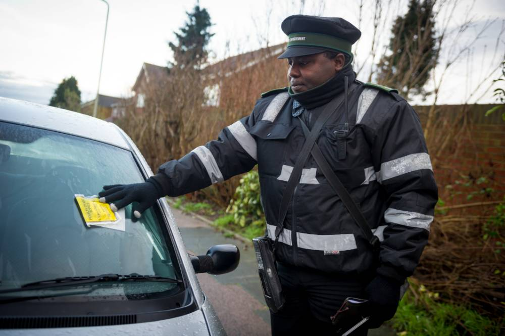 Traffic wardens given police guard after angering parents