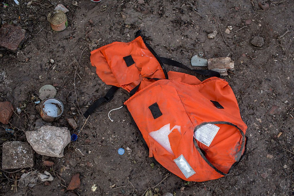 CESME, TURKEY - JANUARY 12: A discarded life jacket is seen left behind at an unfinished resort complex, used by refugees and migrants while waiting for smugglers boats to take them to the greek Island of Chios on January 12, 2016 in Cesme, Turkey. The unfinished resort bungalows situated on the top of a cliff on the Cesme peninsula became the waiting point for refugees and migrants who had organised smugglers to take them to Chios island in Greece. Many of the refugees and migrants, predominantly from Syria, Afghanistan, and Iraq would often have to wait days or weeks on the cliff top for the smugglers to arrive with a boat and the right weather conditions for the dangerous trip. Turkish authorities earlier this week cleared the site of all people and are now forbidding anyone from accessing the area in an attempt to stop the flow of refugees and migrants to Greece. (Photo by Chris McGrath/Getty Images)