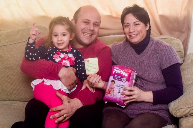 PIC FROM MERCURY PRESS (PICTURED: FRANCESCO GRECO, 35, WITH WIFE GRAZIELLA MESSINA AND DAUGHTER KAROLA) A pregnant mum was shocked after her husband discovered a heart-warming letter and £10 note hidden behind nappies in a supermarket. Mum-of-one Graziella Messinaís husband Francesco Greco, 35, came across the generous surprise in Asda in the Middlebrook Retail Park in Horwich, Bolton on January 10. McDonaldís worker Graziella, 37, is mum to three-year-old daughter Karola Greco and is currently eight months pregnant with a second daughter. She said she and Francesco have been struggling to make ends meet since she took maternity leave and said the compassionate 'gesture of love' restored their faith in humanity - and may even have come from heaven. SEE MERCURY COPY