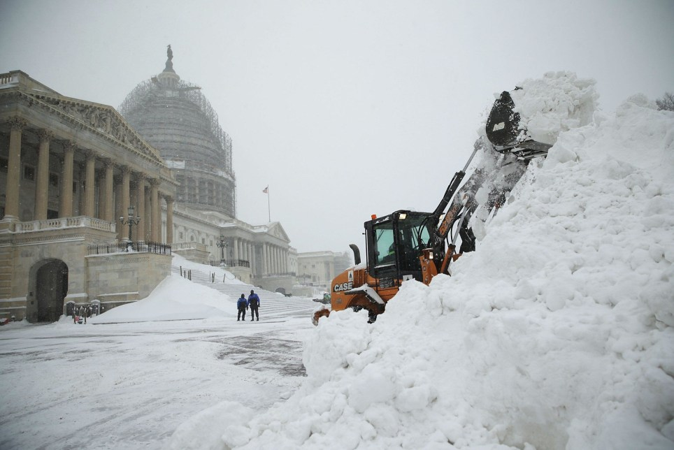 """WASHINGTON, DC - JANUARY 23: A bulldozer clears snow on the East Front of the U.S. Capitol January 23, 2016 in Washington, DC. Heavy snow continued to fall in the Mid-Atlantic region causing """"life-threatening blizzard conditions"""" and affecting millions of people. (Photo by Alex Wong/Getty Images) *** BESTPIX ***"""