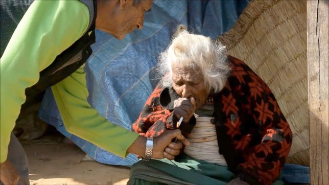 PIC FROM CATERS NEWS - (PICTURED: Batuli Lamichhane smoking) - A 112-year-old woman has credited her old age to chain smoking 30 cigarettes a day - for 95 YEARS. Batuli Lamichhane was born in March 1903 - and took up smoking when she was 17. And she claims its her daily habit that has helped her outlive almost everyone else in her village - and her own children. She said: I dont really care how old I am. But I am old nonetheless. I have seen a lot of things change during my lifetime. But despite her age, Batuli continues to be a chain smoker. She smokes as many as 30 cigarettes a day. SEE CATERS COPY.