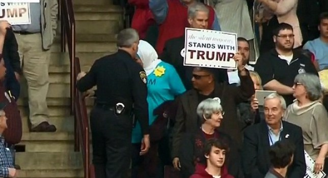 Rose Hamid is escorted out of the event Picture: CNN)