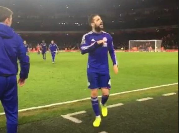 Cesc Fabregas pats Chelsea badge in response to booing Arsenal fans