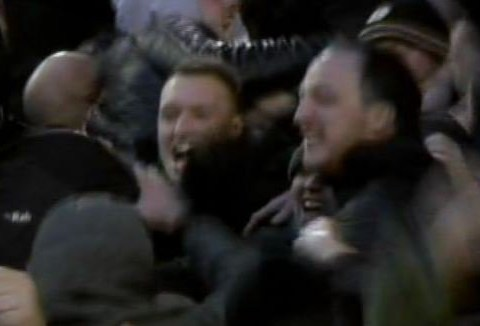 Phil Jones celebrates Wayne Rooney's winner v Liverpool with Manchester United fans