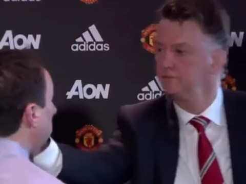 Manchester United boss Louis van Gaal pats journalist on the face after Ashley Cole question