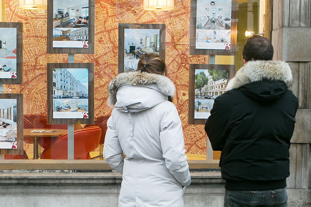 File photo dated 04/12/14 of a women and a man looking in an estate agent window. The estimated number of first-time buyers slipped back in 2015 for the first time in four years as the typical deposit needed tipped over the £30,000 mark, according to a report. PA