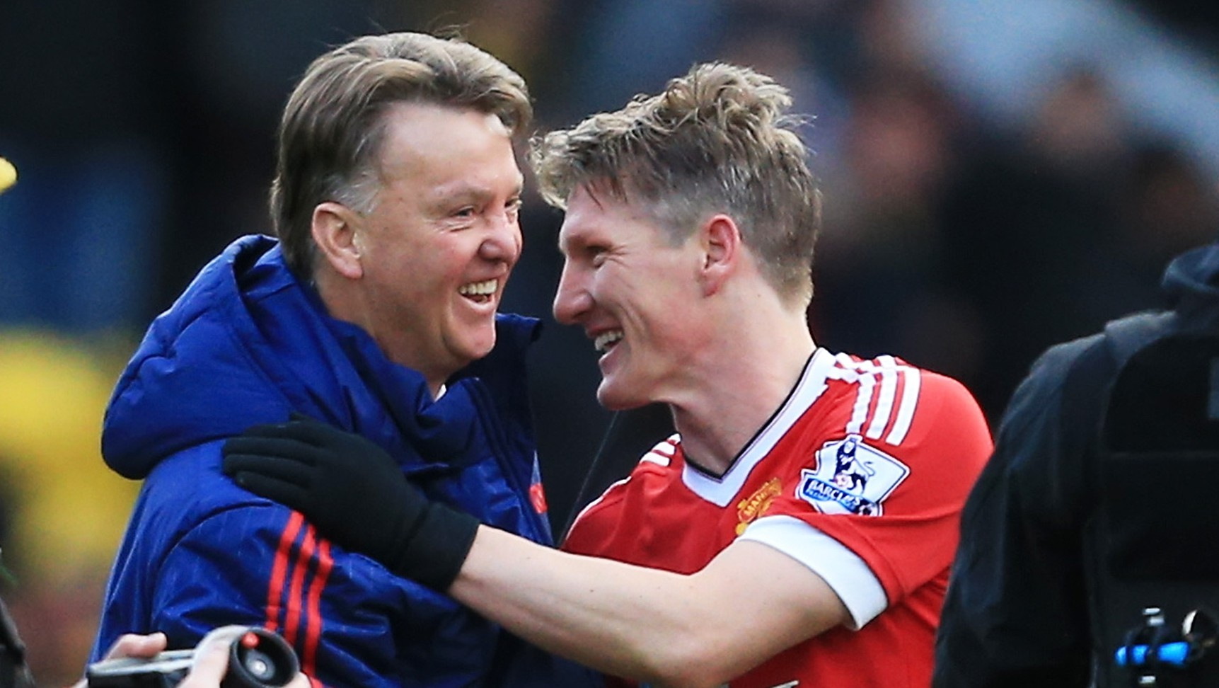 WATFORD, ENGLAND - NOVEMBER 21: Manager Louis van Gaal (2nd L) and Bastian Schweinsteiger (2nd R) of Manchester United celebrate their 2-1 win in the Barclays Premier League match between Watford and Manchester United at Vicarage Road on November 21, 2015 in Watford, England. (Photo by Stephen Pond/Getty Images)