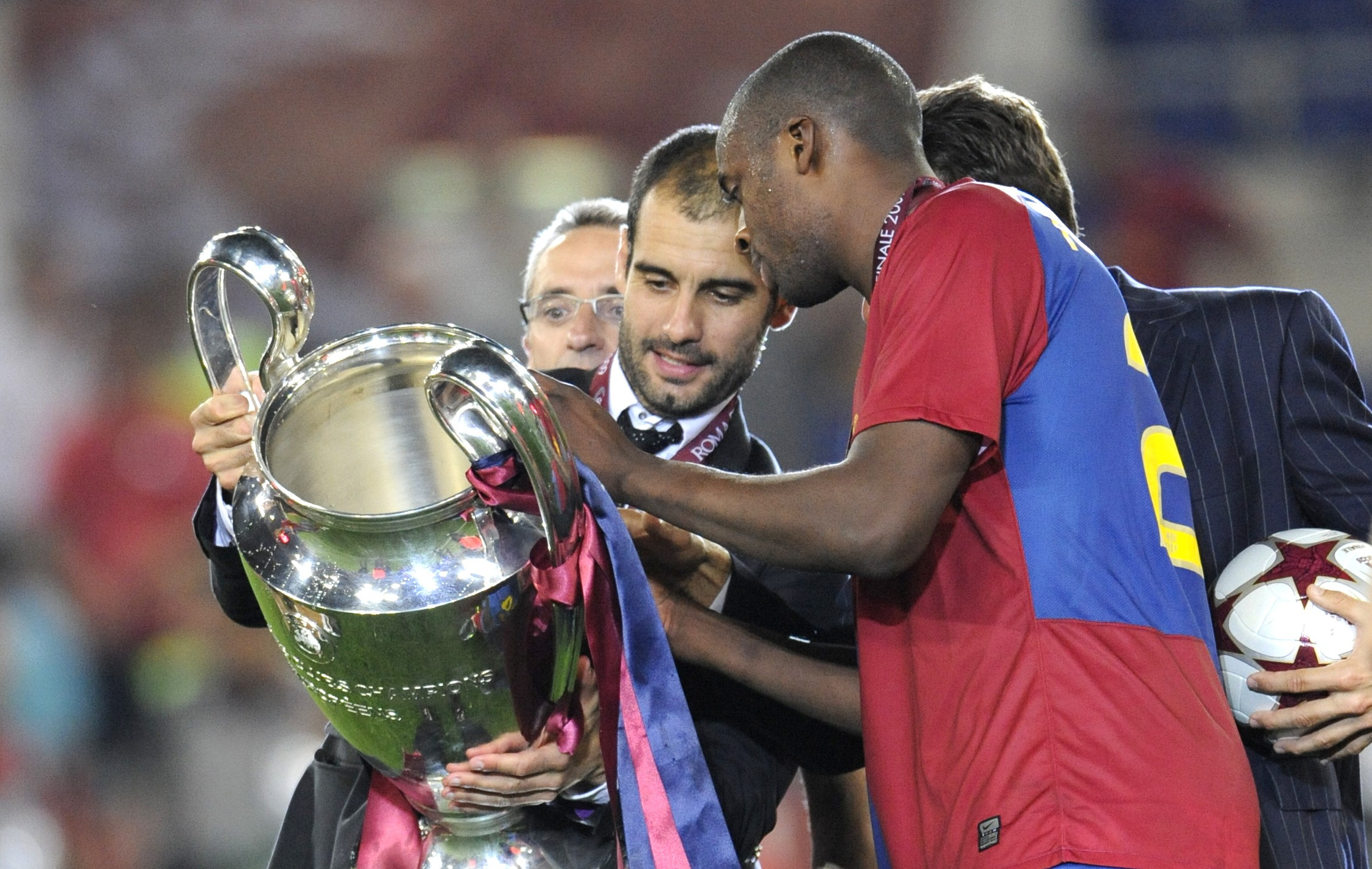ROME - MAY 27: Barcelona coach Josep Guardiola holds the trophy with Yaya Toure (right) after the UEFA Champions League Final match between Barcelona and Manchester United at the Stadio Olimpico on May 27, 2009 in Rome, Italy. Barcelona won the match 2-0. (Photo by Bob Thomas/Getty Images)