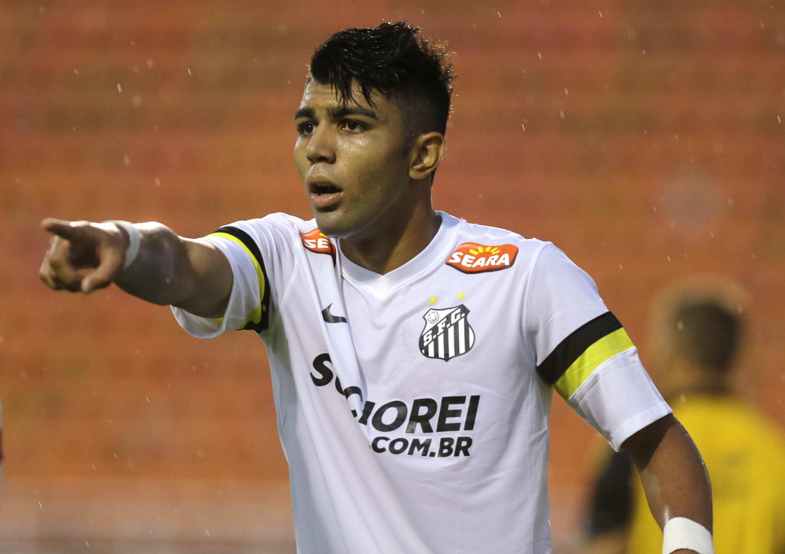 In this Jan. 21, 2014 photo, Santos' Gabriel Barbosa reacts during a Campeonato Paulista soccer game at Pacaembu stadium, in Sao Paulo, Brazil. Santos striker Gabriel Barbosa doesnít like the comparison, but Brazilians see him as the next Neymar. Howís that for pressure? The 19-year-old Barbosa, who is known universally as ìGabigol,î is ranked as Brazilís most promising player. (AP Photo/Nelson Antoine)