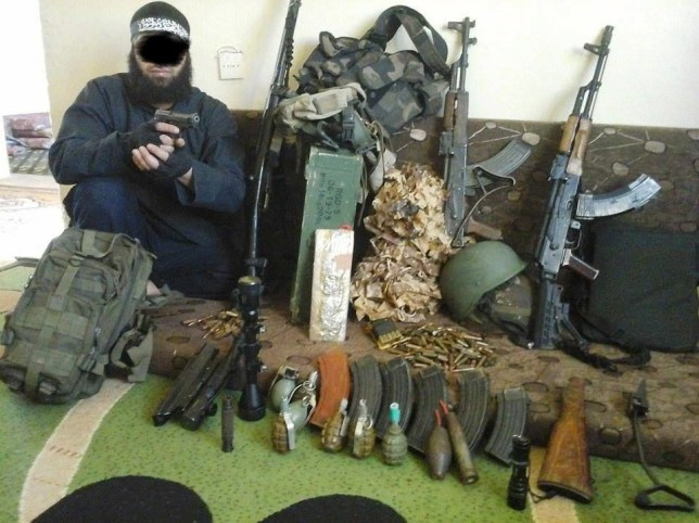 A Berlin police handout photo made available on February 5, 2016, shows a 34-year-old male suspect from Algeria, who was arrested during Thursday's raid in North Rhine-Westphalia, posing in a personal photo in a combat zone in Syria. German forces arrested two men on Thursday suspected of links to Islamic State militants preparing an attack in the German capital, police and prosecutors said, amid fears of another deadly attack on European soil. Police and special forces raided four flats and two offices in Berlin and properties in the northern regions of North Rhine-Westphalia and Lower Saxony. REUTERS/Berlin Police/Handout via ReutersATTENTION EDITORS - THIS PICTURE WAS PROVIDED BY A THIRD PARTY. REUTERS IS UNABLE TO INDEPENDENTLY VERIFY THE AUTHENTICITY, CONTENT, LOCATION OR DATE OF THIS IMAGE. IT IS DISTRIBUTED EXACTLY AS RECEIVED BY REUTERS, AS A SERVICE TO CLIENTS. EDITORIAL USE ONLY. NOT FOR SALE FOR MARKETING OR ADVERTISING CAMPAIGNS. NO RESALES. NO ARCHIVE. PICTURE MASKED AT SOURCE.