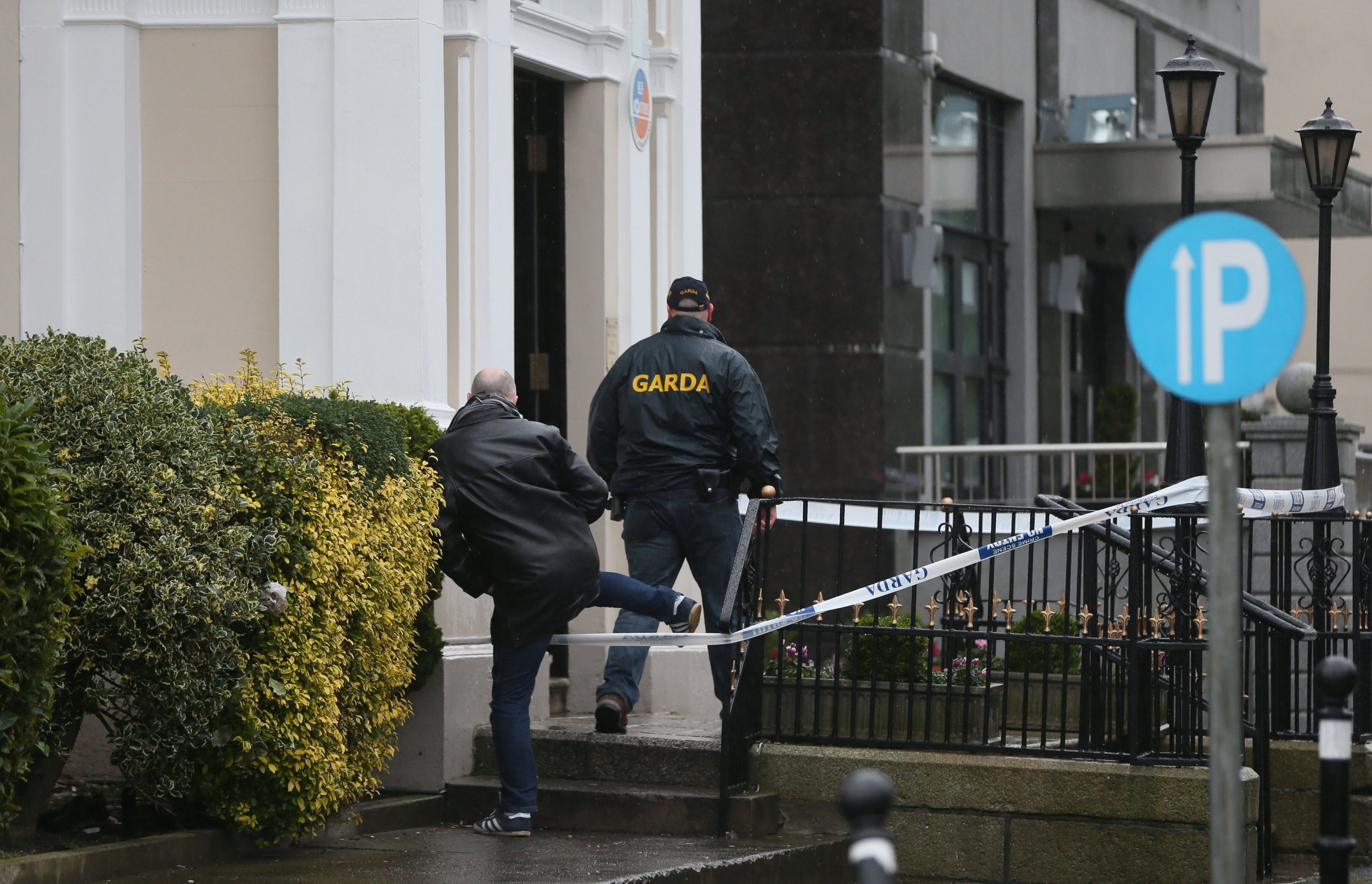 Gardai outside the Regency Hotel in Dublin after one man died and two others were injured following a shooting incident at the hotel. PRESS ASSOCIATION Photo. Picture date: Friday February 5, 2016. The attack happened while a boxing tournament weigh-in was going on at the hotel on Swords Road, around three kilometres north of the city centre. See PA story POLICE Shooting. Photo credit should read: Niall Carson/PA Wire