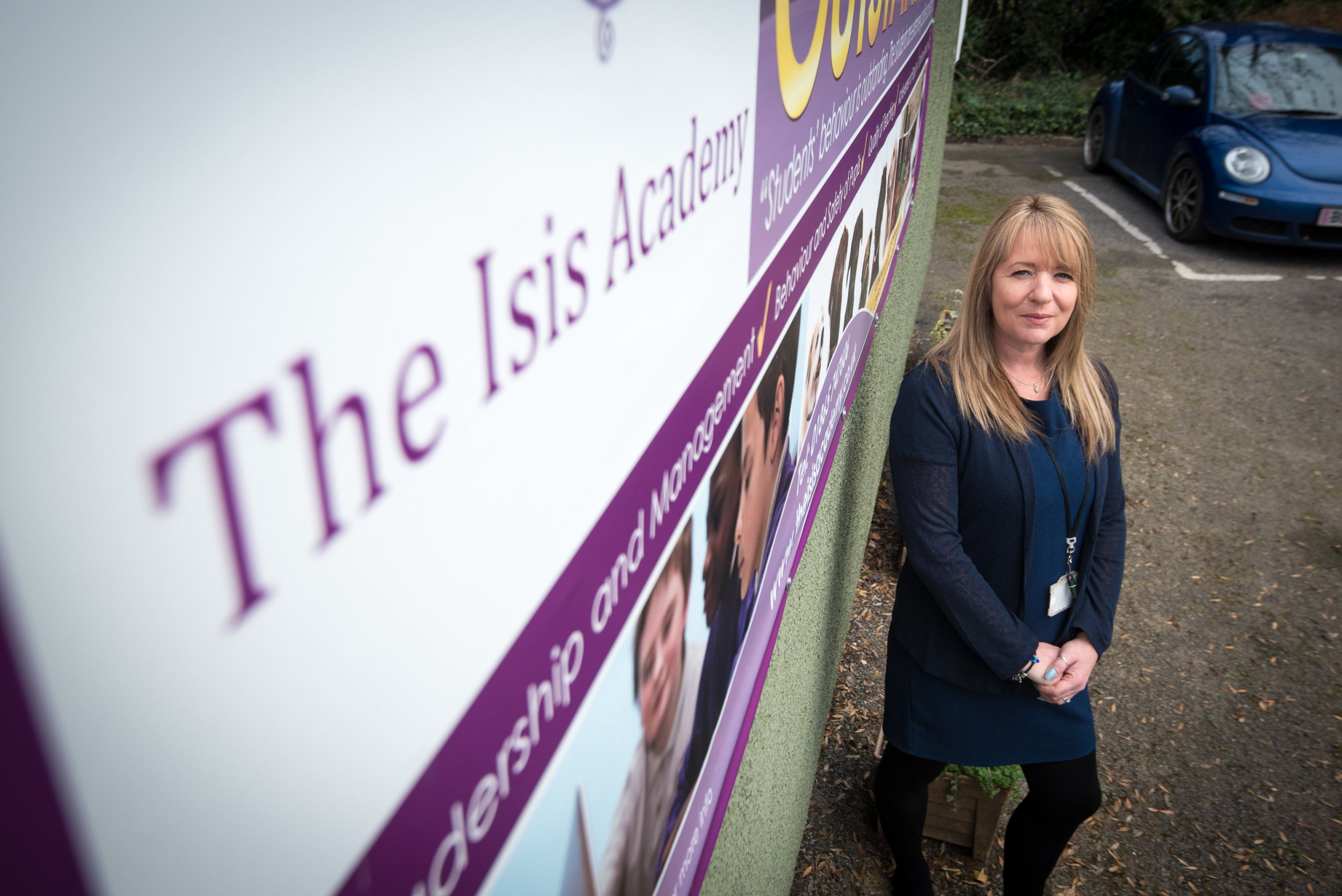 Kay Willett with one of the old signs at the newly renamed Iffley Academy - the school has changed its name because it used to be called Isis Academy. See SWNS story SWTERROR; A school called 'Isis Academy' has been forced to change its name - after jibes about pupils being trained as terrorists. The school in Oxford has been re-branded Iffley Academy to avoid confusion with the Islamic State in Iraq and Syria (ISIS). It was given the unfortunate monicker after becoming an academy in 2013 and was named after part of the River Thames which flows nearby and is known as 'The Isis'. Headteacher Kay Willett decided to change the name after being asked 'are you training the children to be terrorists?' and photos of pupils and terrorists appeared when she searched the school online.
