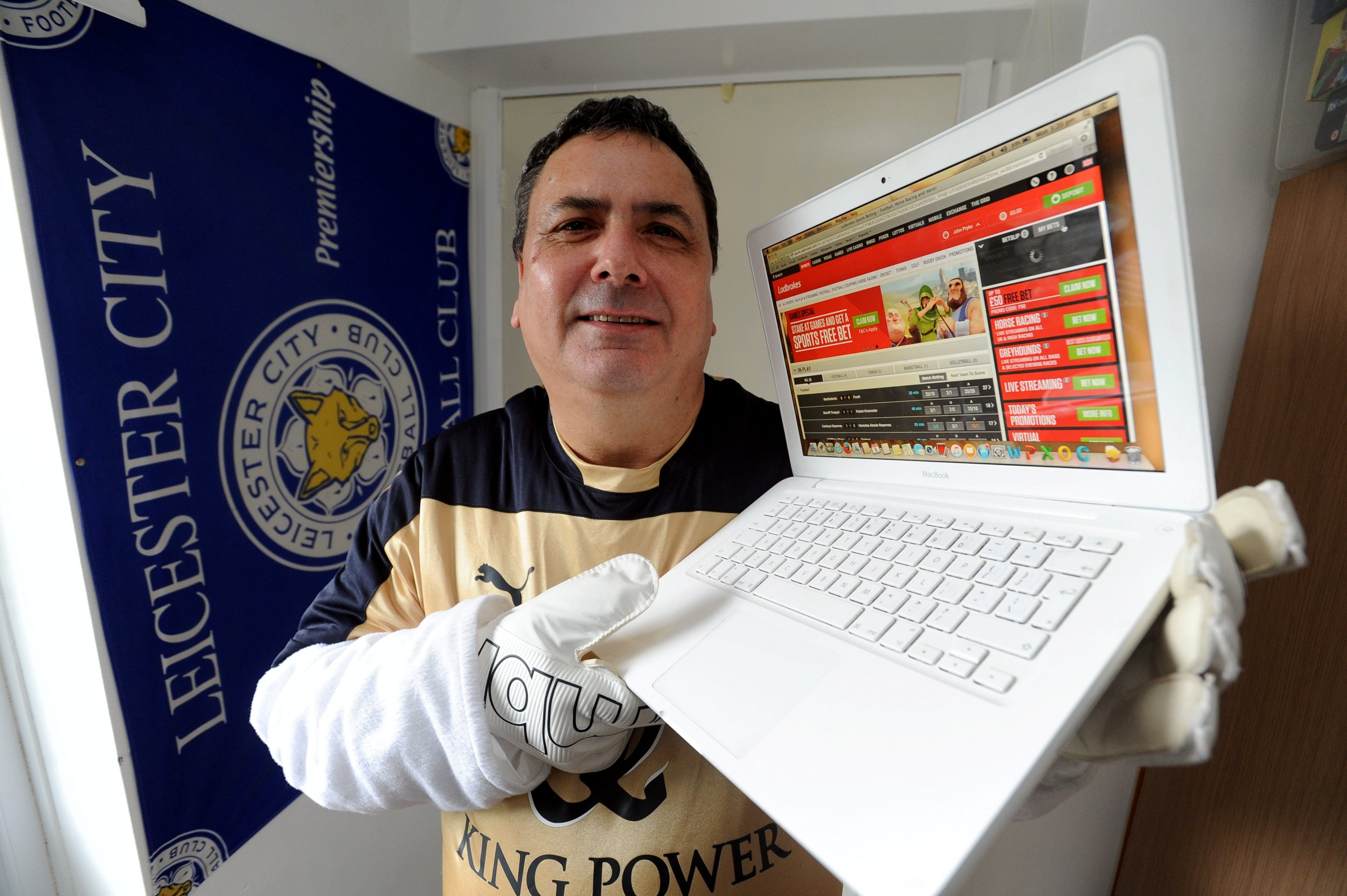 "Football fan John Pryke who stands to pocket over £104,000 if Leicester City win the Premier League - Pictured is John with the Ladbrokes website displaying his bet. See NTI story NTIFAN. Nervous Leicester City fan John Pryke stands to pocket £100,000 if the blues win the league - after taking out an unlikely £20 bet on Claudio Ranieri's men to win the title. John, 59, of Leicester Forest East, spotted the 5,000-1 bet at the start of the season. ""The odds were so good, I just thought: 'Well, that's not bad ñ I fancy that' so I had a bet on them,"" he said. ""I remember when Greece won the European Championships in 2004, as late entrants. No-one fancied them. They were 500-1 to win it and I remember my son, Christopher, said to me: 'They'll win it, dad,' and I laughed at him. Lo and behold, they did. I didn't want to miss out like that again."