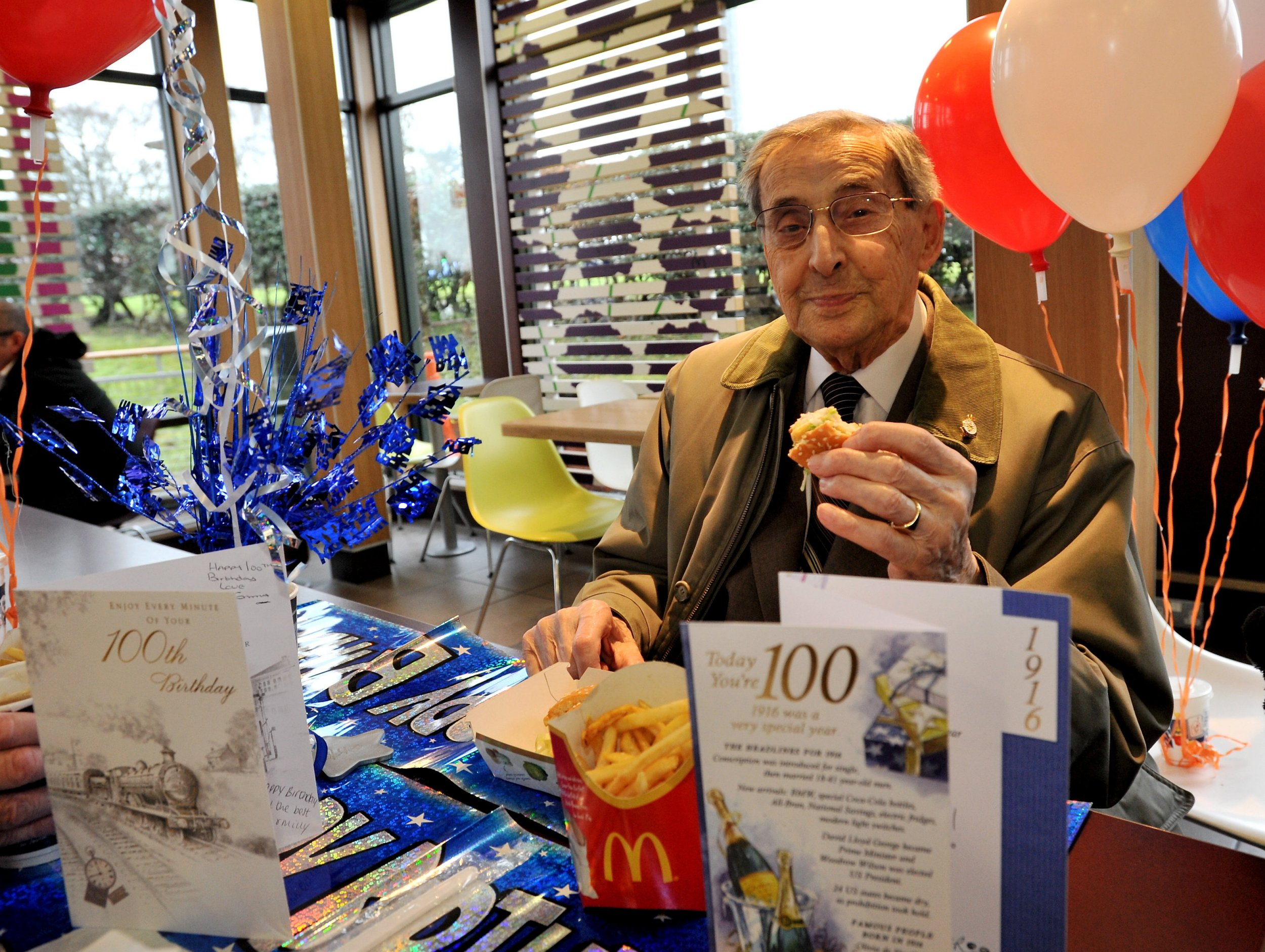 100-year-old Arthur Probert enjoying McDonalds as part his birthday celebrations. A UTTOXETER centenarian marked his milestone birthday in an unusual way ñ by enjoying his favourite meal at fast food giant McDonald's. While Arthur Probert, who lives near to Thomas Alleyne's High School, also enjoyed a party with loved ones and a very special coffee morning with his friends from St Mary's Parish Church, the father-of-two knew the only real way to mark turning 100 was to tuck into a McChicken Sandwich meal. He opted for the unusual birthday treat to continue a weekly tradition of heading to the restaurant for a bite to eat. Mr Probert also told the Advertiser that his secret to a long life was his 'very good wife' Doris, who he celebrated his 70th wedding anniversary with before he lost her at the age of 95 four years ago.