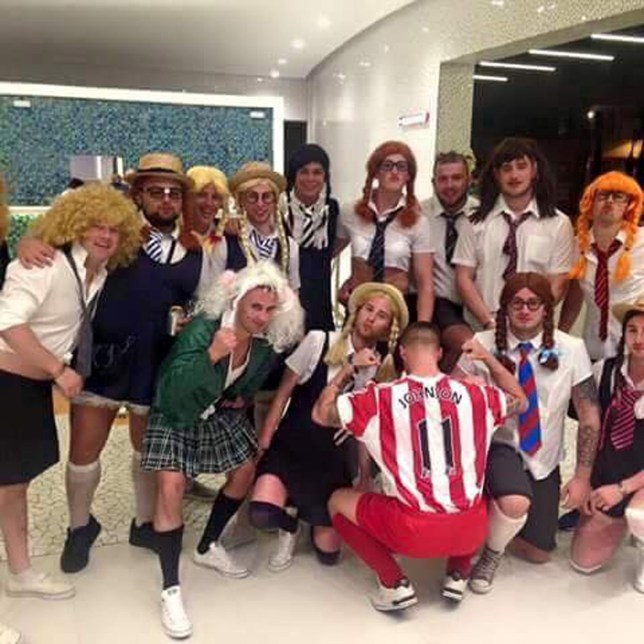 Football-loving lads on holiday in Magaluf have mocked disgraced Premier League star Adam Johnson by dressing up as the footballer ñ and thirteen SCHOOLGIRLS. See SWNS story SWSTAG. A picture posted on the Facebook group Boro Bible ñ a group dedicated to Middlesbrough FC, Johnson's former team - shows the group out on the lash in uniforms and wigs. One of the group is show wearing a Sunderland shirt bearing Johnsonís name and number. The picture, captioned ëbest stag night everí, has been shared more than 4,700 times and has 7,000 likes.