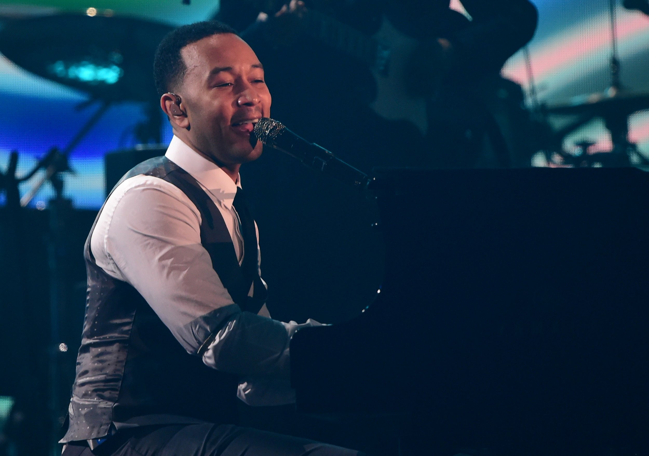 Singer-songwriter John Legend perfroms onstage during the 58th Annual Grammy music Awards in Los Angeles February 15, 2016. AFP PHOTO/ ROBYN BECKROBYN BECK/AFP/Getty Images