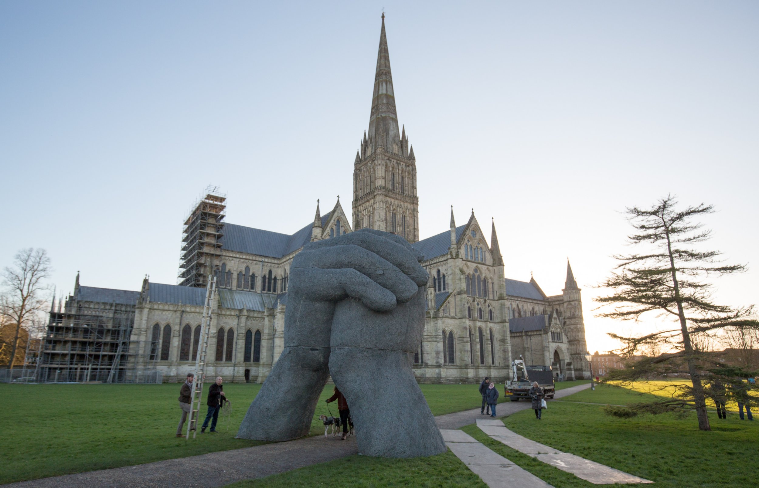 SALISBURY, ENGLAND - FEBRUARY 10: Sophie Ryder's sculpture The Kiss, is installed in the grounds of Salisbury Cathedral as part of an exhibition by the artist on February 10, 2016 in Salisbury, England. The solo exhibition, Relationships, featuring life-sized Minotaurs, Lady Hares and giant 20ft high clasped hands installed in and around the historic Cathedral, opens on February 12 and runs until July 3 (Photo by Matt Cardy/Getty Images)