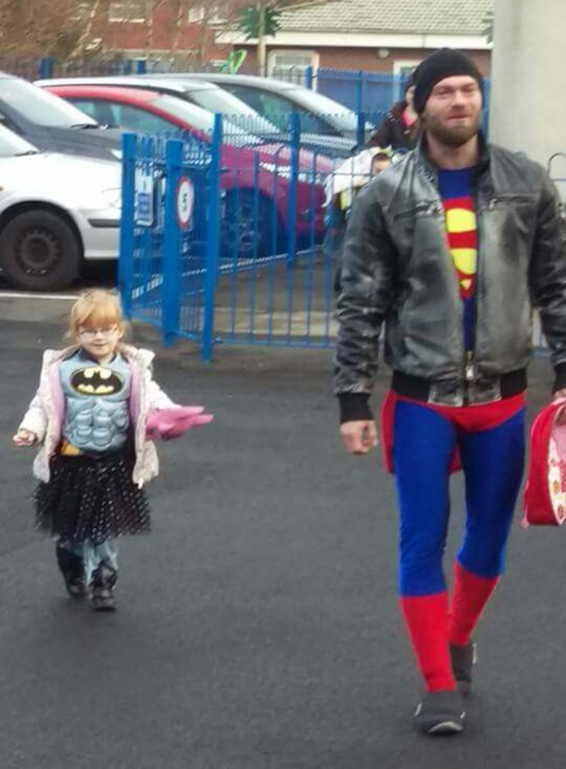 PIC FROM MERCURY PRESS (PICTURED: Danny Arnold, 29, and his daughter Phoebe, 3, dressed as superheroes) A tot who refused to go to school dressed as Batman because it was a boy's costume is over the moon when her dad dresses as Superman to walk her to school. Danny Arnold, from St Helens, Merseyside, decided to dress up alongside his three-year-old daughter, Phoebe, after she refused to wear her Batman outfit to school in case people laughed at her. The 29-year-old claims his daughter loves Batman and had been working on her costume to wear to school for their Superhero day all week - but thought she might look silly because it's a 'boy's outfit'. In a bid to get his daughter to school, Danny decided he'd put on a Superman outfit to walk her to school in, and their photo has since gone viral with more than 900 shares. SEE MERCURY COPY