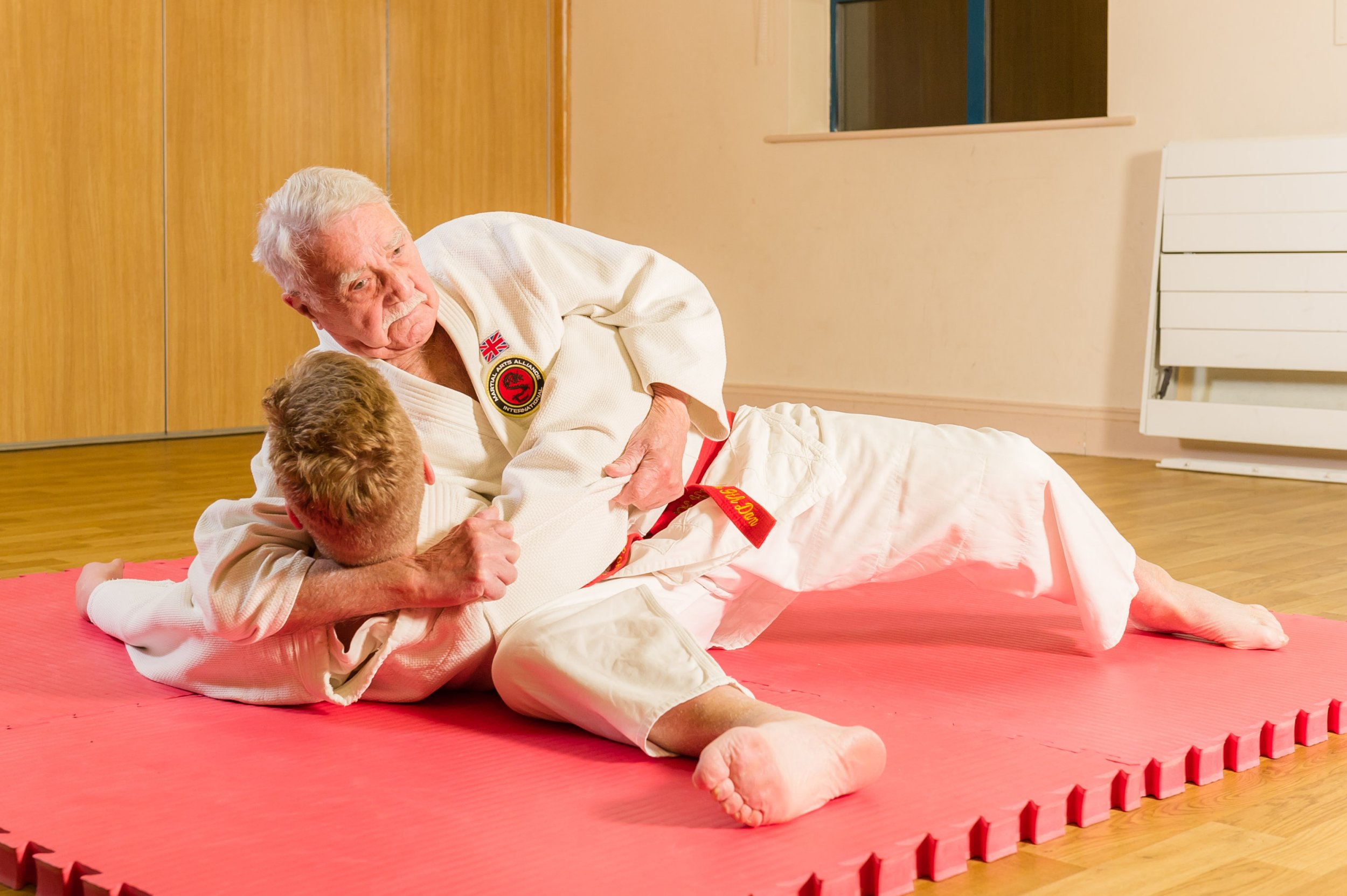 *** EXCLUSIVE - VIDEO AVAILABLE *** CRAMLINGTON, UNITED KINGDOM - FEBRUARY 11: 92-year-old Judo sensei, Jack Hearn, giving instruction during a judo lesson. Pictured on February 11, 2016 in Cramlington, Northumberland, England. CONDITION OF USAGE: The following byline must be used Groupon / Barcroft Media. MARTIAL arts master Jack Hearn is the oldest active Judo Sensei in the UK - and at 92-years-old, he has no plans of bowing out. The great-great-grandfather, from Cramlington, Northumberland, holds a 9th Dan black belt, making him one of the countryís highest graded players. Now the plucky pensioner, is working alongside Groupon on a campaign to encourage Britainís retirees to try something new. Recent research from Groupon has found that retired Brits are now 15% more active than the rest of the nation and spend more time outdoors than most 18-24 year olds, with 35% saying that risky activities make them feel younger. Jack will be offering five lucky winners the chance to train with him in one of his Judo classes. To enter the free deal to be in with a chance of winning visit: www.gr.pn/jack PHOTOGRAPH BY Barcroft Media / Groupon UK Office, London. T +44 845 370 2233 W www.barcroftmedia.com USA Office, New York City. T +1 212 796 2458 W www.barcroftusa.com Indian Office, Delhi. T +91 11 4053 2429 W www.barcroftindia.com