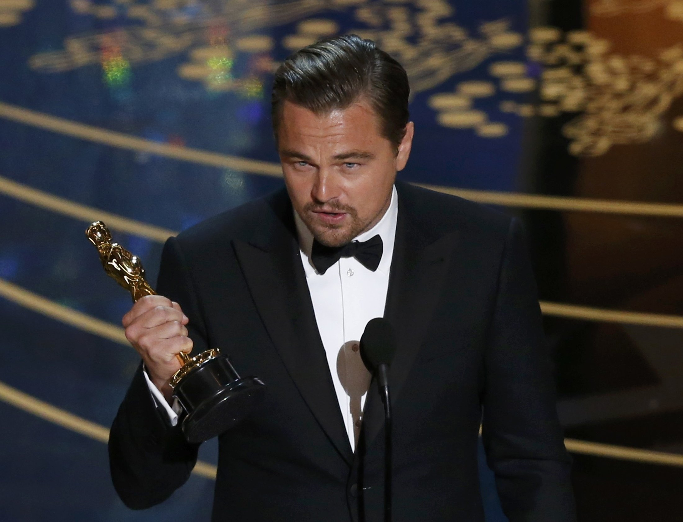 """Leonardo DiCaprio accepts the Oscar for Best Actor for the movie """"The Revenant"""" at the 88th Academy Awards in Hollywood, California February 28, 2016. REUTERS/Mario Anzuoni"""