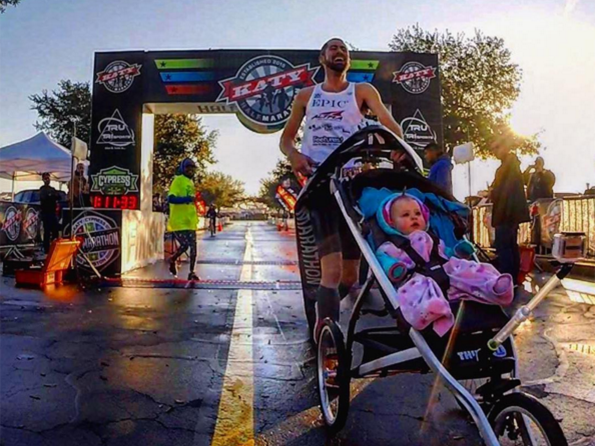 Dad wins half-marathon and breaks world record while pushing his baby in a pram