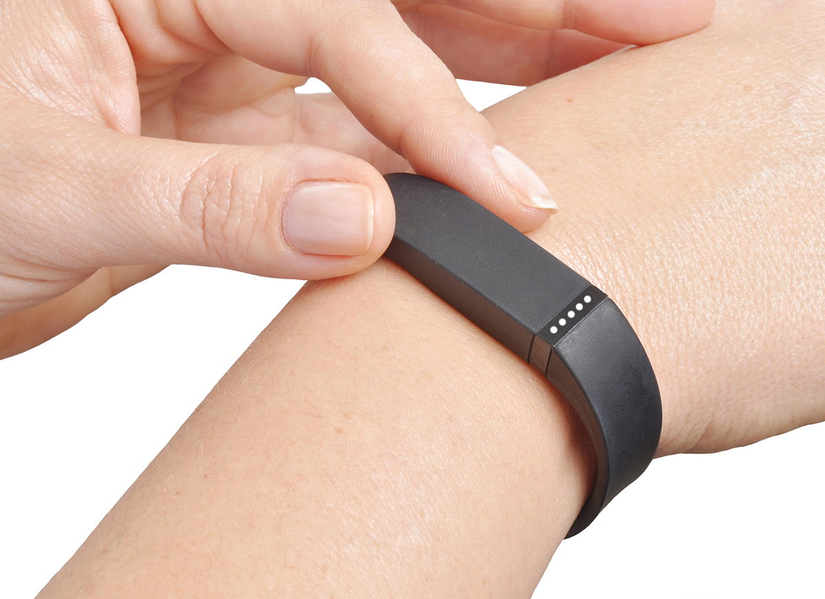 EDP1M2 Activity fitness tracker on woman's wrist Alamy