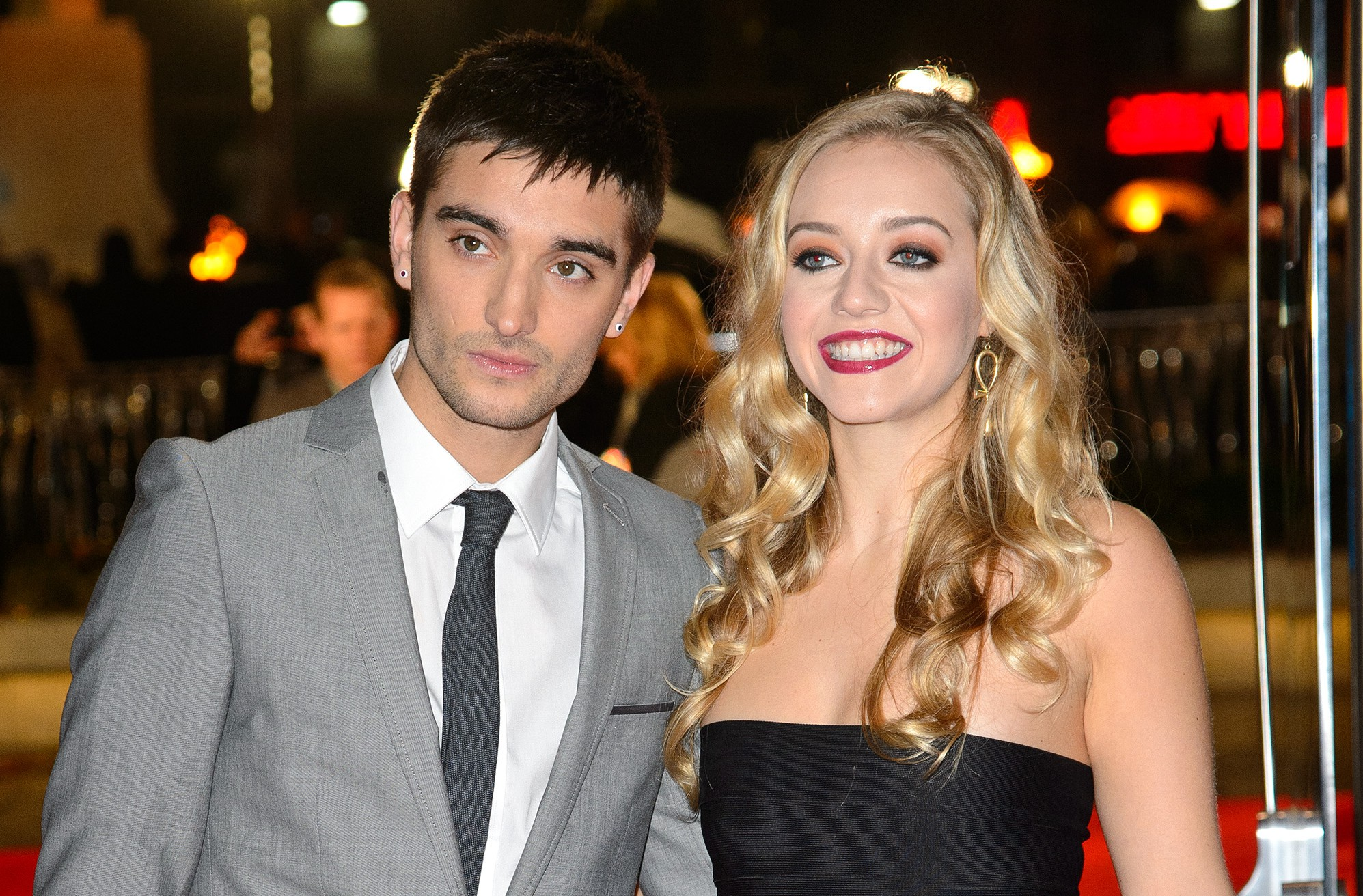 """LONDON, ENGLAND - NOVEMBER 11: (L-R) Tom Parker and Kelsey Hardwick attend the UK Premiere of """"The Hunger Games: Catching Fire"""" at Odeon Leicester Square on November 11, 2013 in London, England. (Photo by Dave J Hogan/Getty Images)"""