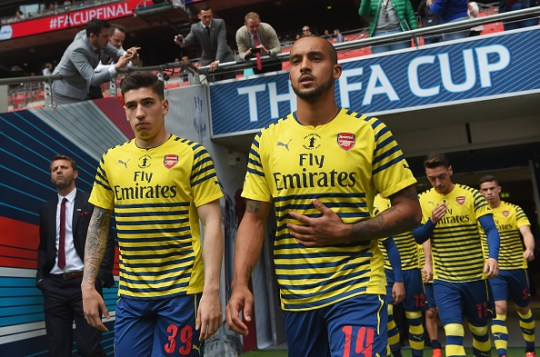 LONDON, ENGLAND - MAY 30: (L-R) Hector Bellerin and Theo Walcott of Arsenal walk onto the pitch to warm up prior to the FA Cup Final between Aston Villa and Arsenal at Wembley Stadium on May 30, 2015 in London, England. (Photo by Michael Regan - The FA/The FA via Getty Images)