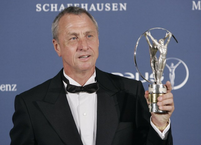 FILE - In this Monday May 22, 2006 file photo, Dutch soccer legend Johan Cruyff holds his lifetime achievement award during the Laureus World Sports Awards in Barcelona, Spain. Dutch soccer great Johan Cruyff has died in Barcelona on Thursday, March 24, 2016 at age 68. (AP Photo/Manu Fernandez, file)