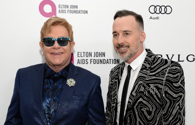 WEST HOLLYWOOD, CA - FEBRUARY 28: Co-hosts Sir Elton John (L) and David Furnish attend the 24th Annual Elton John AIDS Foundation's Oscar Viewing Party at The City of West Hollywood Park on February 28, 2016 in West Hollywood, California. (Photo by Michael Kovac/Getty Images for EJAF)