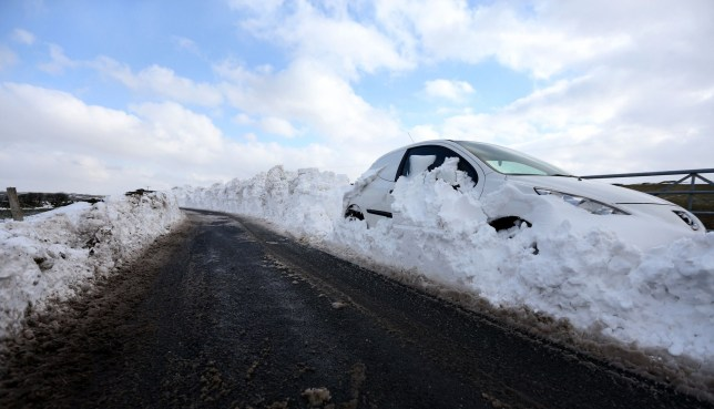 Storm Jake. Credit: PA Images. A car sits on the side of the road, surrounded by snow and seemingly abandoned by its owner, in the Briercliffe area of Burnley. A weekend of freezing cold weather and snow is continuing to cause disruption today, with thousands of homes across the UK without power and many roads still impassable.