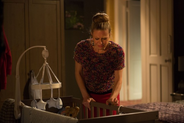 WARNING: Embargoed for publication until 00:00:01 on 08/03/2016 - Programme Name: Eastenders - TX: 14/03/2016 - Episode: 5245 (No. n/a) - Picture Shows: Linda panics when she realises something isn't right with Ollie. Linda Carter (KELLIE BRIGHT) - (C) BBC - Photographer: Jack Barnes
