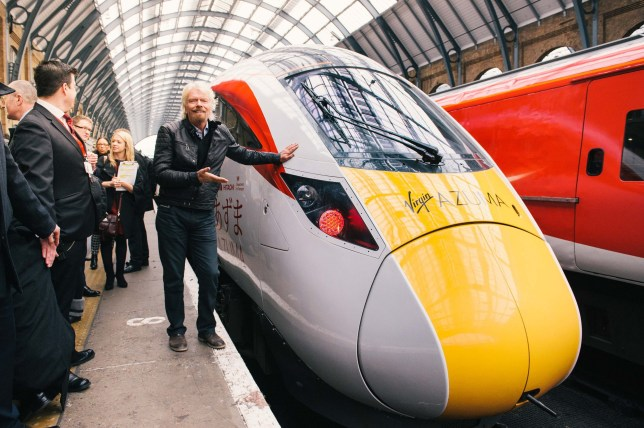 Handout photo issued by Virgin Trains of Sir Richard Branson unveiling the Virgin Azuma, the first of their new fleet which will cut journey times on the East Coast Main Line by up to 22 minutes, at King's Cross station in London. PRESS ASSOCIATION Photo. Picture date: Friday March 18, 2016. The trains, which will be launched in 2018, will enable passengers to travel between London and Edinburgh in four hours and will accelerate from 0-125mph around a minute quicker than the current fleet. See PA story RAIL Virgin. Photo credit should read: Mikael Buck/Virgin Trains/PA Wire NOTE TO EDITORS: This handout photo may only be used in for editorial reporting purposes for the contemporaneous illustration of events, things or the people in the image or facts mentioned in the caption. Reuse of the picture may require further permission from the copyright holder.