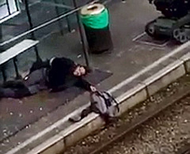 A suspect lies on the platform of a tramway station, in this image taken from amateur video, after he was shot and wounded by police in the Brussels borough of Schaerbeek following Tuesday's bombings in Brussels, Belgium, March 25, 2016. Sudpresse via REUTERS ATTENTION EDITORS - THIS PICTURE WAS PROVIDED BY A THIRD PARTY. IT IS DISTRIBUTED BY REUTERS AS A SERVICE TO CLIENTS. EDITORIAL USE ONLY. NOT FOR SALE FOR MARKETING OR ADVERTISING CAMPAIGNS. NO RESALES. NO ARCHIVE. BELGIUM OUT. NO COMMERCIAL OR EDITORIAL SALES IN BELGIUM.