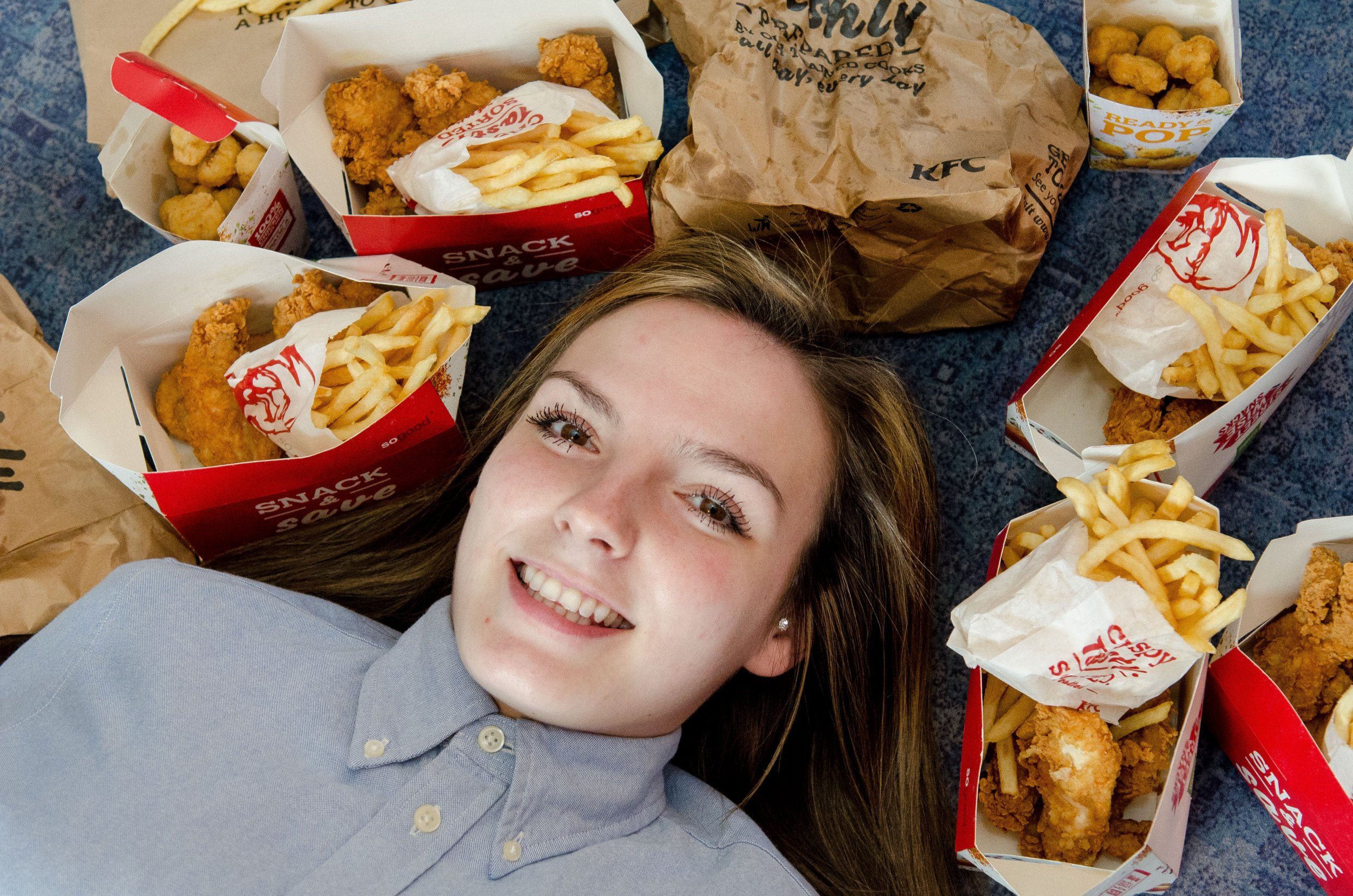 PIC BY JAMES NEWELL/MERCURY PRESS (PICTURED: GEORGIA SCOTNEY, 21, WITH KFC FOOD) A woman who ate KFC chicken and chips for THREE years straight because of an eating disorder is finally cured and can try other foods for the first time. Georgie Scotney, from Portsmouth, had Selective Eating Disorder from a young age and for as long as she can remember has only ever been able to eat chicken and chips because she was too afraid to try anything else. She would even go for days without eating if she was away on a school trip and for the past three years all the 21-year-old had been able to eat was KFC chicken strips or popcorn chicken with chips. SEE MERCURY COPY