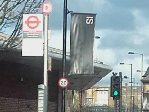 Why is there a black 'IS' banner in Hackney?