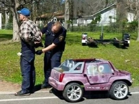 'Driver' arrested behind the wheel of a pink electric toy car