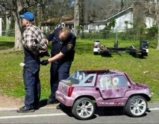 "from Chris Murphy 01634 686 515 A 'driver' was arrested behind the wheel of a pink electric toy car when officers discovered he was a man wanted for other alleged offences. Stunned cops couldn't believe their eyes when they arrived at the scene in San Jacinto County, Texas. They found a man trundling down the road at the controls of a Power Wheels electric car that is normally for kids aged 5-10. A spokesman at the police station said: ""Yes, that story is perfectly true. We were just as surprised when the report turned out to be spot on. ""Someone who was passing took the picture and it has caused a lot of amusement."" The Eastex Advocate reported the driver was pulled over while cruising around Shepherd in a pink Cadillac Escalade, though it was clearly not made by General Motors. It said Deputy Nathan Deweese arrested the driver, David Schumaker but not for his choice of vehicles. Instead he was arrested on a charge of credit card abuse. After being dispatched to Shepherd to investigate the incredible sighting, Deweese reportedly found Schumaker driving around the neighbourhood in the pink Power Wheels. Locals say they had seen Schumaker using the undersized toy car as his personal transportation. ""We have had calls about this guy driving around,"" said Lt. David Lawrenz. Schumaker is alleged to have stolen a credit card from a woman in the area who knows him personally. ""The lady saw him go across the street,"" said Lt. Lawrenz. ""She got an alert on her phone showing that card was being used."" At the time of his arrest, Schumaker reportedly was looking for a battery for his toy car. The toy car has since gone into another individual's possession. ""It was released to a family member. It wasn't towed,"" said Lt. Lawrenz, jokingly. ends"